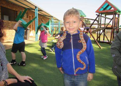 Alec van Schalkwyk is baie trots om die slang om sy nek te hou. (M